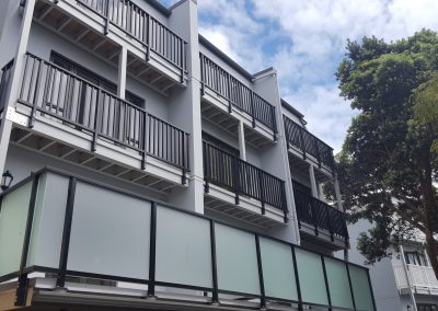 Balustrade with Opaque Panels and Extreme Balustrade - Nairn Street Apartments