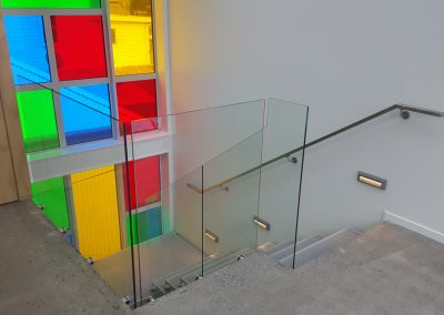 Continuous Handrail and Offset Double Disc Frameless Glazed Balustrade
