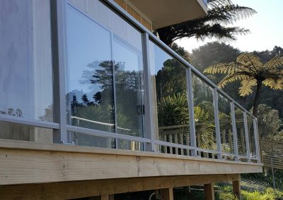 Framed Decor Glazed Balustrade custom made and top fixed to timber deck