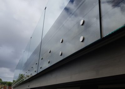 Frameless Glass Balustrade with double disc offsets