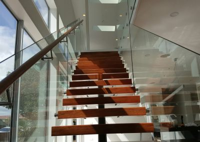 Frameless Glazed Balustrade with timber Handrail