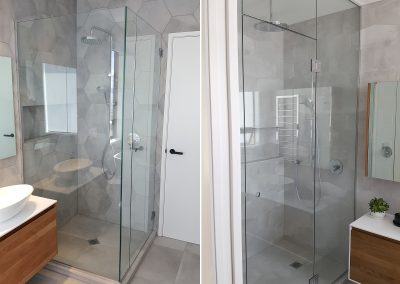 Frameless Shower Box on plinth with handleless door