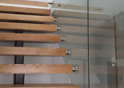 Frameless shaped Glass Balustrade for stairs and landing combined