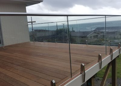 Glass Vice Balustrade with large stainless steel oval top cap