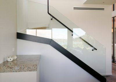 Glazed stair balustrade wih concealed face fixed channel for clean lines
