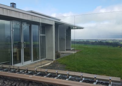 Overheight Frameless Glazed Windage Screen to suit architectural design