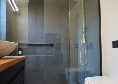 Sliding Shower Door with black hardware