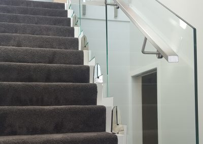 Rectangular stainless steel handrail mounted to Glass Vice Balustrade