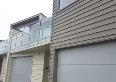 Frameless Glass Balustrades with double disc offset Queens Point
