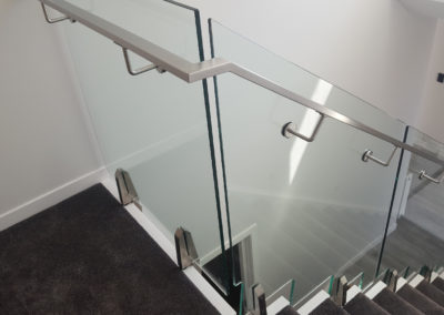 Glass Vice Panels shaped to stairs and Stainless Steel Handrail fixed to glass