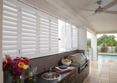 Shutters give weather protection for outdoor rooms