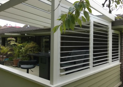 Shutters help create outdoor entertaining areas