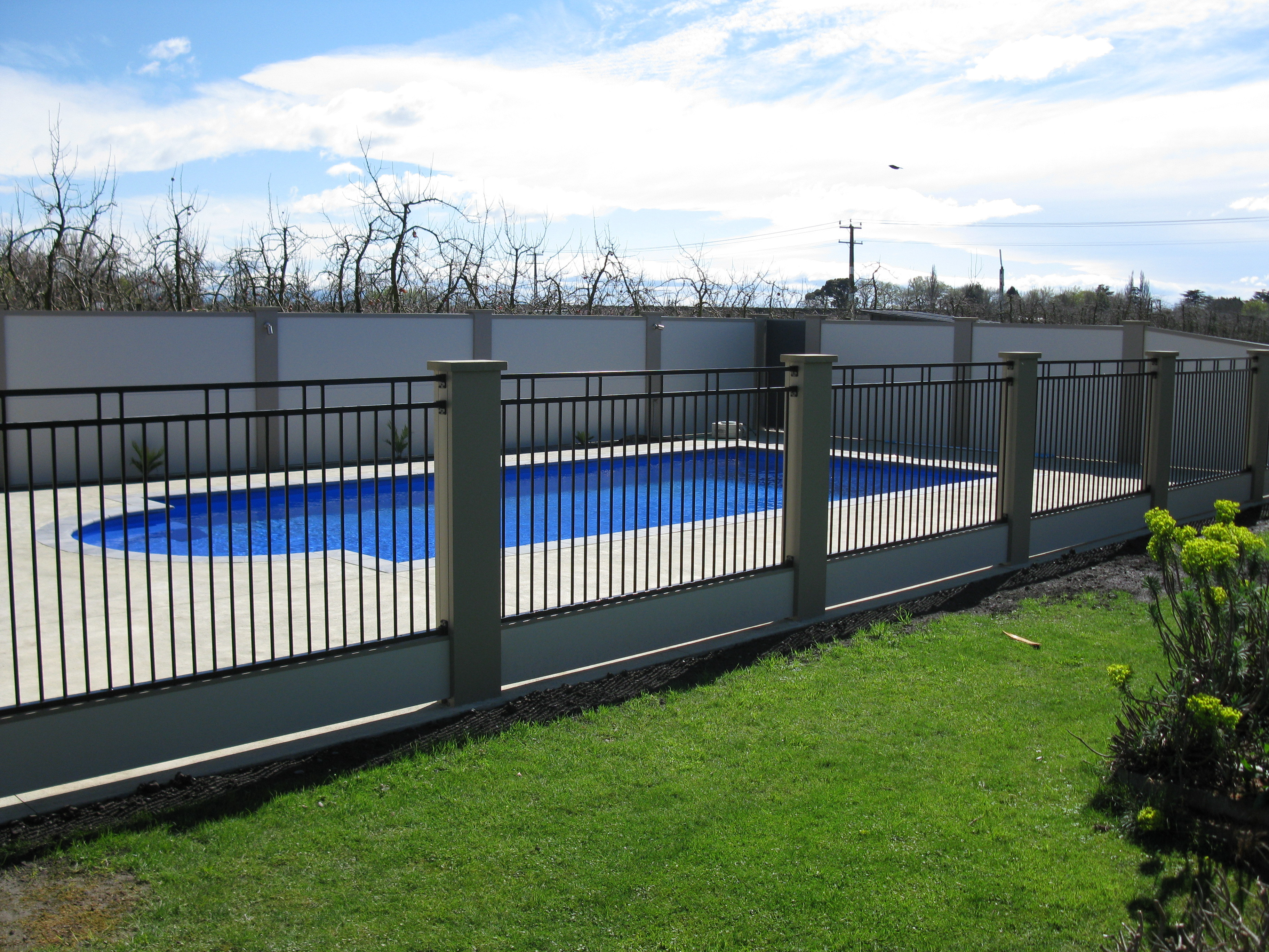 Modular Urban fence panels with concrete filled columns for pool enclosure