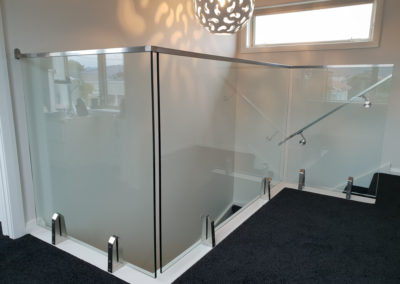 Glass Vice balustrade with stainless steel nano top rail and handrails