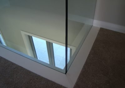 Frameless channel set glazed balustrade offers clean sleek lines
